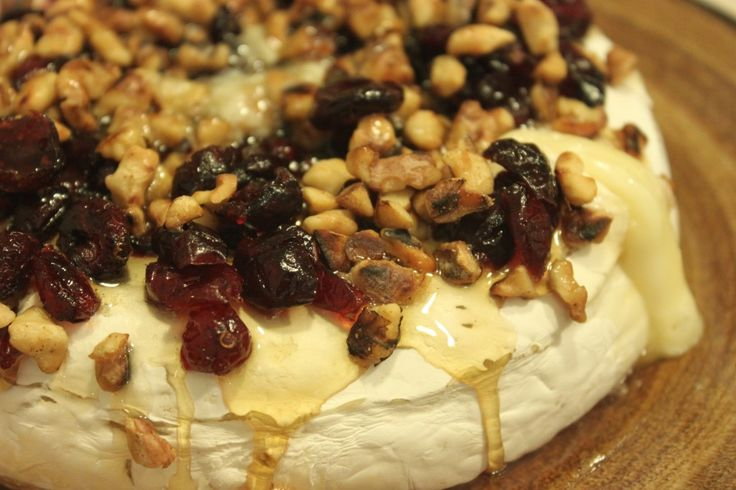 Cranberry Walnut Baked Brie is quick, easy and oozing with flavour. Your taste buds will crave more with each tart, sweet, crunchy bite. This is a crowd pleaser every time and is best enjoyed with crackers or a fresh baguette. #brie #bakedbrie #cranberry #fall #appetizer #walnuts http://www.outtolunchcreations.com/recipes/cranberry-walnut-baked-brie/